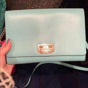 A mint green Kate spade shoulder purse